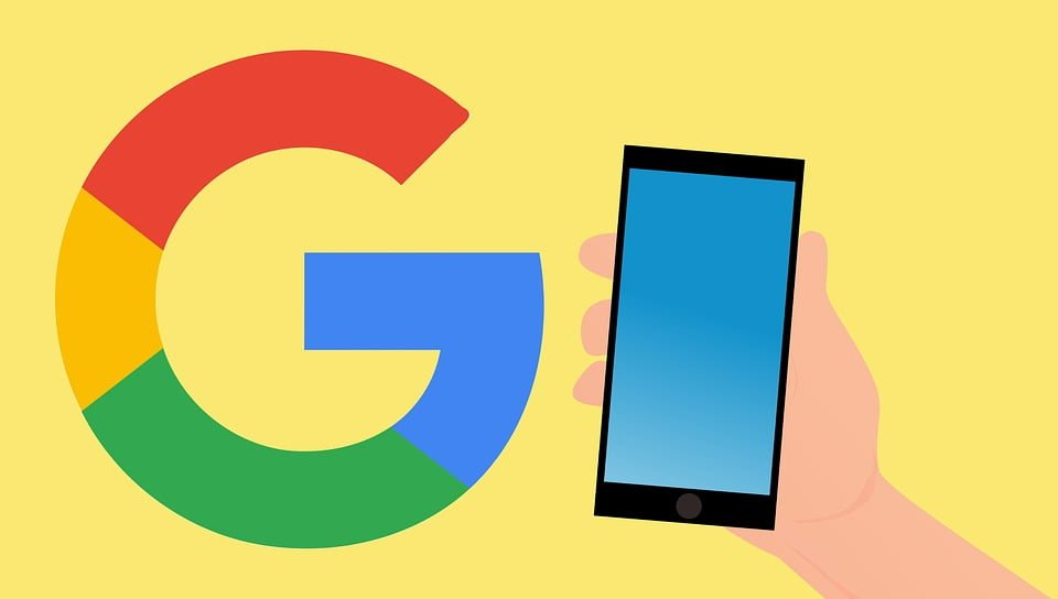 A Google logo with a hand holding a smartphone in a yellow background.