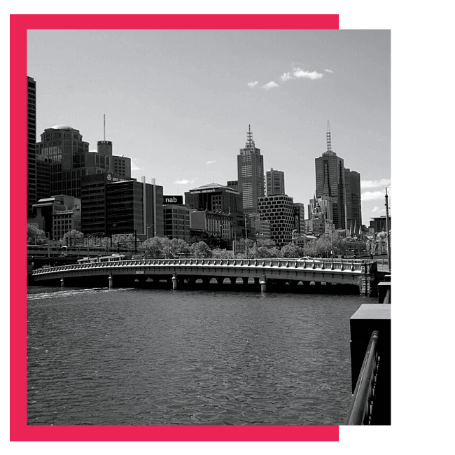 A greyscale shot of Melbourne city with a red border.