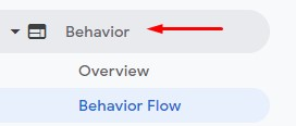 """A photo of a red arrow pointing to the """"Behavior"""" tab in Google Analytics."""